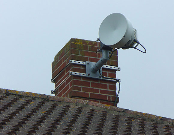 Microwave wifi dish mounted on a domestic chimney